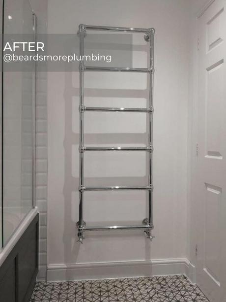 traditional heated towel rail in a white bathroom