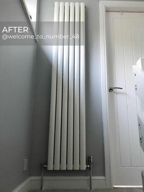 modern vertical radiator in a hallway