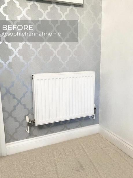 old white radiator on a silver wall