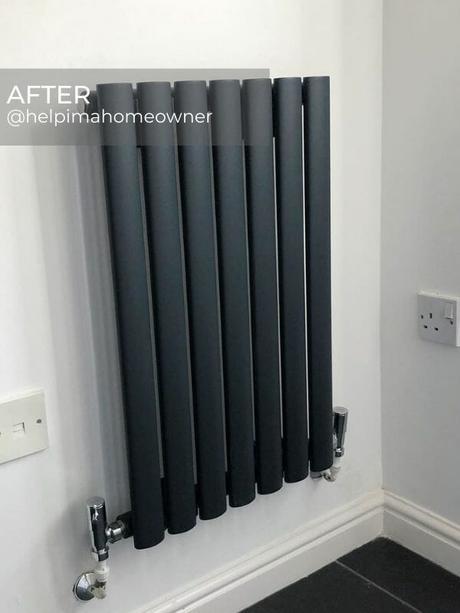 anthracite designer radiator in a corner