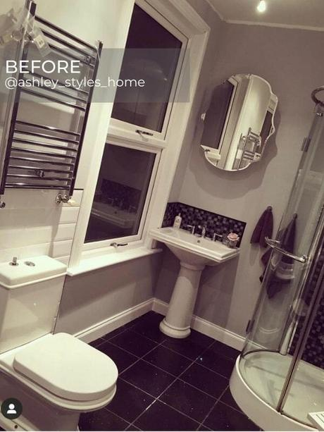 chrome towel rail in a silver bathroom before the renovation