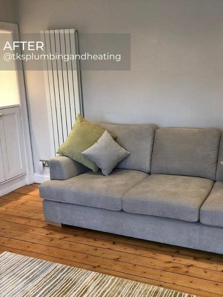 white vertical radiator in a modern living room