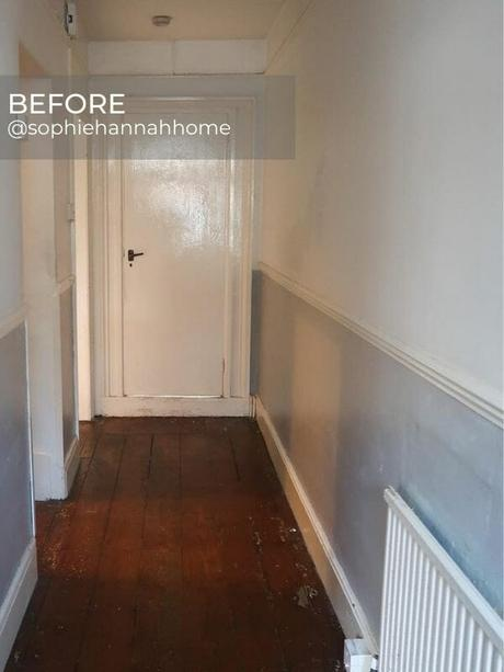 old radiator in a hallway before the renovation