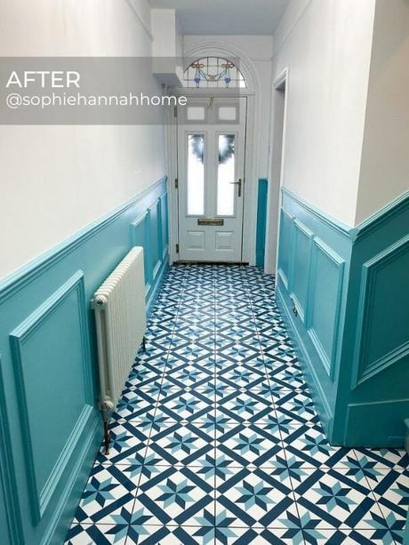 white column radiator in a blue hallway