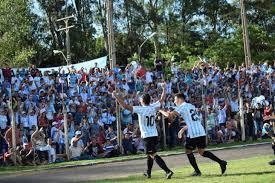 The match is a part of the primera division, apertura. Ante Olimpia Y Cerro De Local En Villarrica Guairena Luis Caceres