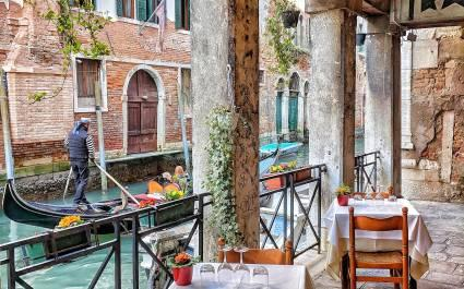 Best time to visit Italy - cafe in Venice
