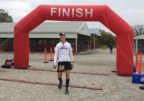 Mike Sohaskey crossing the finish line of the Kansas Rails-to-Trails Fall 50K