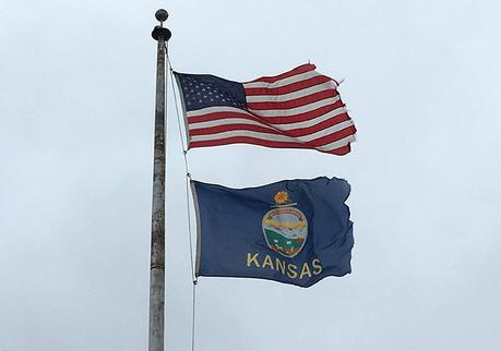 US and Kansas flags waving in the wind