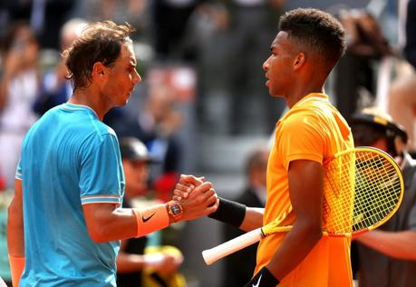 Felix Auger-Alliassime of Canada congratulates opponent, Rafael Nadal of Spain, during day five of the 2019 Mutua Madrid Open.