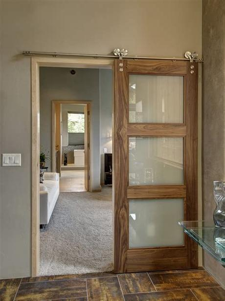 Impact glass garage doors deliver a sophisticated curb appeal and provide unsurpassed protection from tropical storms and hurricanes. Sliding Barn Doors Don't Have to be Rustic! - Sun Mountain ...