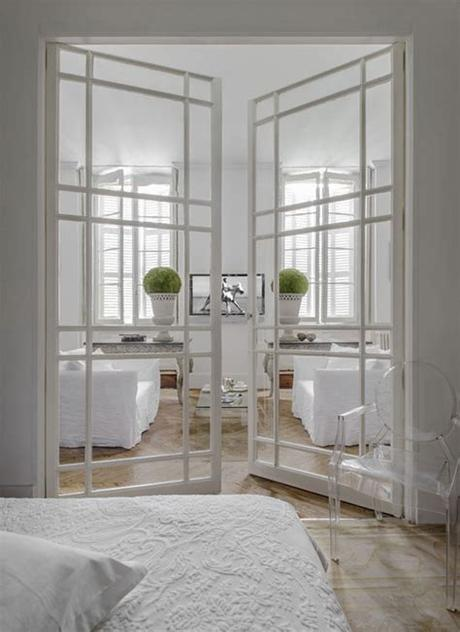 Double sliding glass barn doors These are lovely interior doors. Glass doors with grids ...