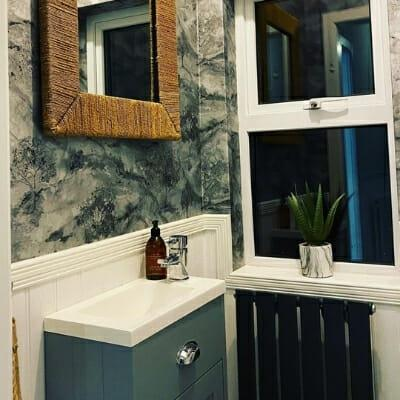 small black radiator in a cloakroom
