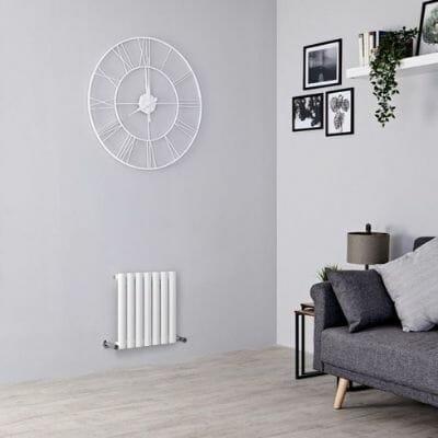 small aruba radiator in a gray living room