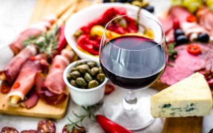 Enchanting Travels Spain Tours Traditional spanish tapas, wine snack set, food from spain, cheese, meat, vegetables and other appetizers on table