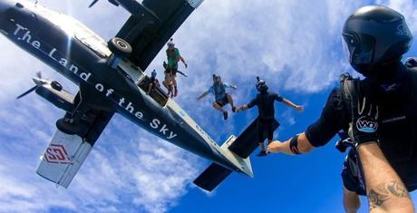 airplane twin otter skydivers clouds blue sky carbon free