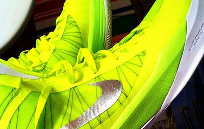 Why Are So Many Of The Olympic Athletes Wearing Bright Green Shoes?