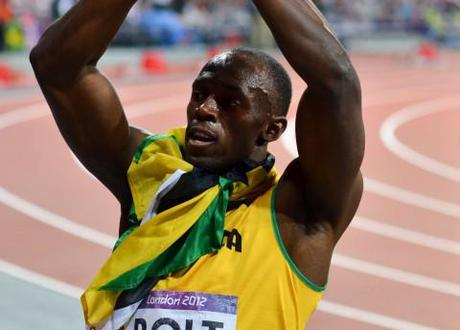 Usain Bolt celebrates after his 200 meter victory at London 2012