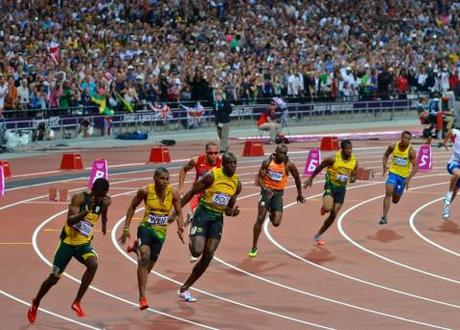 Usain Bolt in lane 7 at the start of the 200m men's sprint at London 2012.