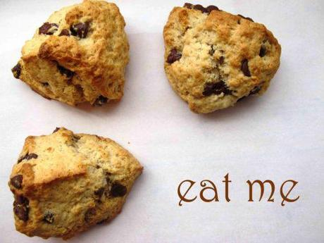 Three chocolate buttermilk scones, and text saying 'eat me'.