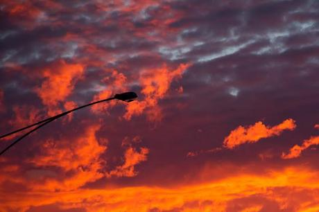 street light in front of red sunrise