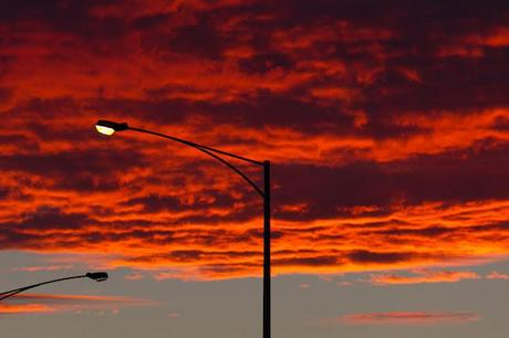 red sunrise and street light