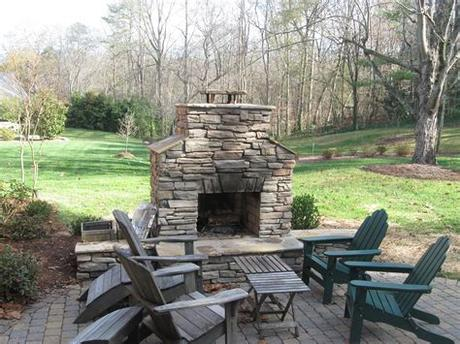 Smaller fireplaces available starting at $2850. Outdoor Stone Fireplace Warming Up Exterior Space - Traba ...