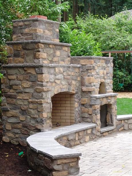 Outdoor stone fireplaces take the comfort of your living room fireplace and move it outside. Outdoor living pizza oven, outdoor fireplace, seating by ...