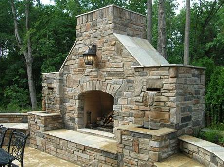 The outdoor stone fireplace is one of a number of outdoor living trends taking the home design world by storm, and with good reason. Outdoor Stone Fireplace Warming Up Exterior Space - Traba ...