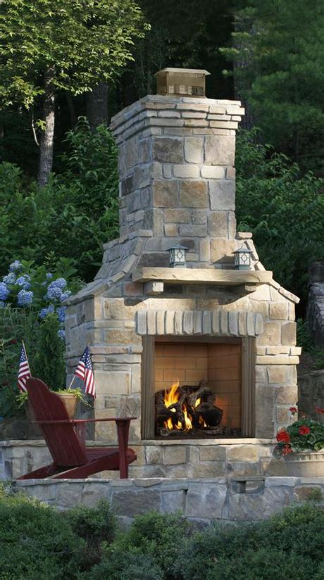 No matter the climate, there are beautiful stone fireplaces in homes all over the world. hhdu.com   Outdoor stone fireplaces, Backyard fireplace ...