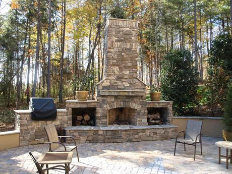 Outdoor Stone Fireplace Warming Up Exterior Space - Traba ...