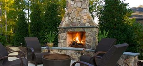 We had looked into an outdoor fireplace but the expense of a mason to build us one was just not in the budget. Outdoor Stone Fireplace surrounds and fireplace designs