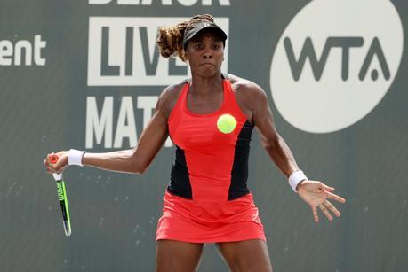 female tennis player playing tennis