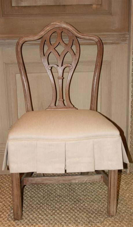 The seat covers were designed to have a universal fit but that does not seem to be the case. Dining chair with slipcovered seat   Dining chair slipcovers