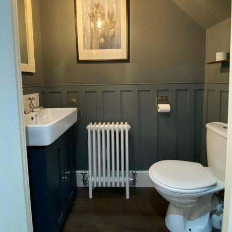 white triple column radiator in a small bathroom