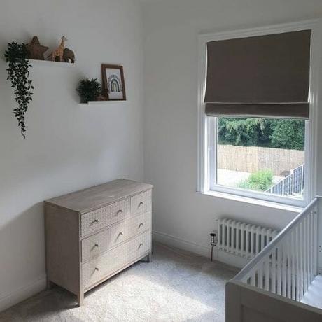 low level column radiator under a window in a nursery