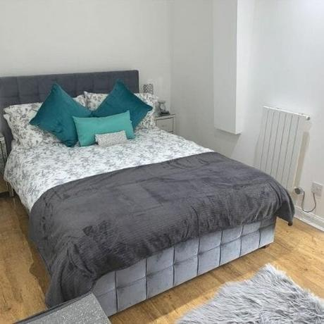small electric radiator in a bedroom