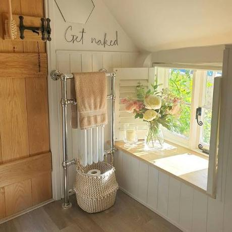 traditional heated towel rail in a cloakroom