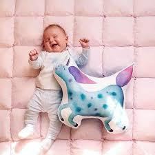 Today's wishes for unicorns will be wishes for narwhals tomorrow, and then wishes for all the glam, graphics and glitter later, and then wishes for black after that — all of which trades out well. Blue Unicorn Cushion Happyspaces