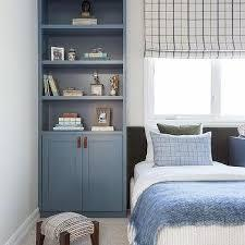 Building a wall cabinet is an ideal option since it doesn't necessarily have to take up any floor space and can provide plenty of room to store clothing, toys or other items. Kids Bedroom Built Ins Design Ideas