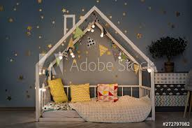 If you visit the white house, you can see the east room, the oval blue room, the green room, the red room, and the state dining room. Modern Kids Bedroom In The Evening White House Bed Decorated With Lights Garland Stock Foto Adobe Stock