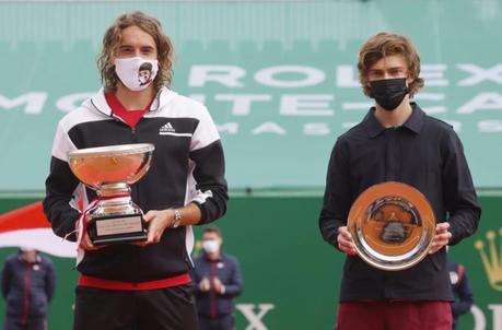 tennis players holding winner trophies