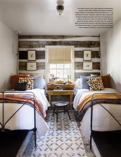 Boho beach bungalow guest room by amelia handegan, pair twin beds, striped rug, canopy bed, guest room ideas, paisley print, eclectic style. Bedroom with two beds. Idea for a shared bedroom. Desk ...