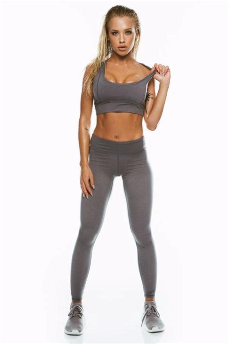 Person showing woman in blue sport bra carrying gray dumbbell. Charcoal Sports Bra   Fitness fashion, Bra, Workout pictures
