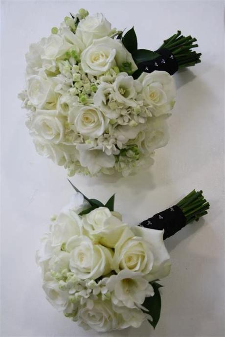 You could switch out the red roses for white roses. The Blossom Tree: Black and White Wedding