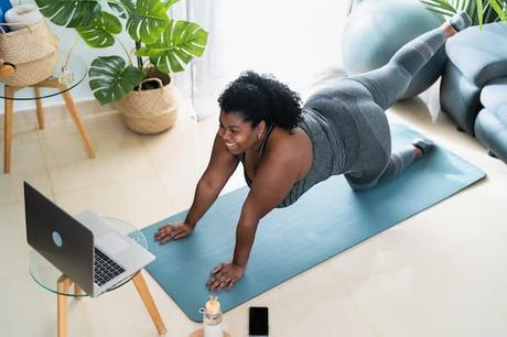 A YouTuber grows her channel by taking a video doing yoga.