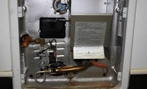 The motor has to spool up and close the circuit on a small switch called a sail switch behind the blower wheel cover. How To Light Rv Water Heater Pilot Rv Hometown