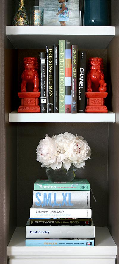vignette: white peonies on the fireplace shelves