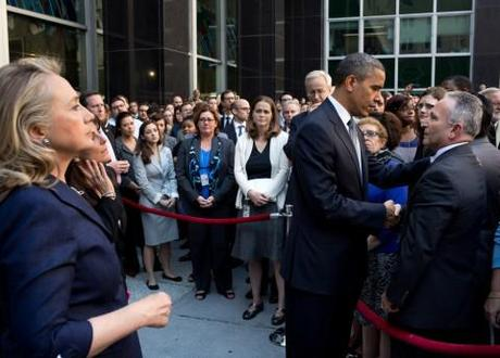 Obama and Clinton greet State Department employees after the death of Christopher Stevens in Libya.