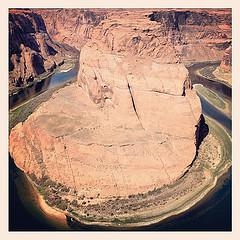 Horseshoe Bend, Page. You may notice tini-tiny white boat at the bottom of the picture. That'll give you the scale.