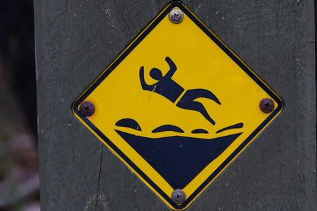 warning sign depicting man falling over